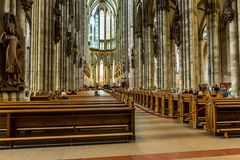 COLOGNE, GERMANY - AUGUST 26: walk way inside the Cologne Cathedral on August 26, 2014 in Cologne, Germany. commenced in 1248 and Stock Photos