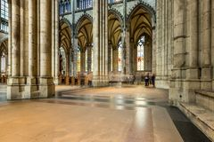 COLOGNE, GERMANY - AUGUST 26: walk way inside the Cologne Cathedral on August 26, 2014 in Cologne, Germany. commenced in 1248 and Royalty Free Stock Images