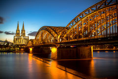 Cologne, Germany. Bridge over Rhine river with Cologne Cathedral in the background at night. Cologne, Germany stock image