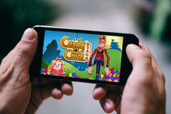 COLOGNE, GERMANY - FEBRUARY 27, 2018: Candy Crush Saga App Game played on Apple iPhone. Candy Crush Saga is a singleplayer online puzzle game in a cartoony Stock Photo