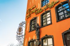 Facade of the Paeffgen pub in the old town of Cologne, Germany. Cologne, Germany - February 24, 2018: facade of the Paeffgen pub in the old town of Cologne. The Royalty Free Stock Photos