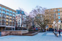 Roncalliplatz and square Am Hof in Cologne, Germany. Cologne, Germany - February 24, 2018: Roncalliplatz and square Am Hof in Cologne, with unidentified people Stock Photo