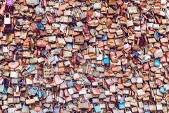 COLOGNE, GERMANY - FEBRUARY 19, 2018: Thousands of love locks which sweethearts lock to the Hohenzollern Bridge to symbolize stock photos