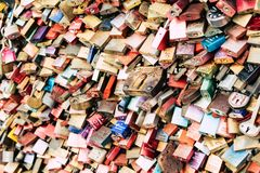 COLOGNE, GERMANY - FEBRUARY 19, 2018: Thousands of love locks which sweethearts lock to the Hohenzollern Bridge to symbolize stock images