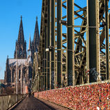 Cologne, Germany - January 19, 2017: Locks of love on the fence of the Hohenzollern Bridge. In the background is the Royalty Free Stock Photography