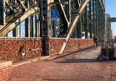 Cologne, Germany - January 19, 2017: Locks of love on the fence of the Hohenzollern Bridge. Stock Image
