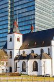 Alt St. Heribert in Cologne-Deutz, Germany, in front of an office tower Stock Photography