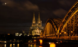 Cologne, Germany in the night. Famous Cathedral and Bridge in Cologne at Twilight royalty free stock photo