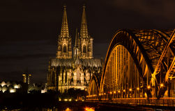 Cologne, Germany in the night. Famous Cathedral and Bridge in Cologne at Twilight Royalty Free Stock Photos