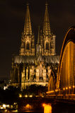 Cologne, Germany in the night. Famous Cathedral and Bridge in Cologne at Twilight Royalty Free Stock Image