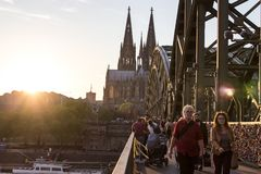 COLOGNE, GERMANY- OCTOBER 06, 2018: Tourists on the Hohenzollern Bridge. as a sign of strong love or strong friendship royalty free stock photos