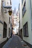 Auf dem Rothenberg street in center of Cologne. COLOGNE, GERMANY - SEPTEMBER 17, 2017: narrow Auf dem Rothenberg street in center of Cologne city. Cologne is stock image