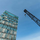 Cologne harbor - old crane new building Royalty Free Stock Image