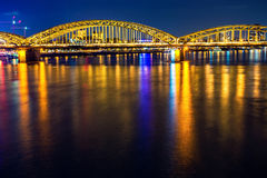 Cologne Hohenzollern bridge night scene. Cologne Hohenzollern bridge through river Rhein night scene stock images