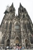 Unidentified people and the view of the Roman Catholic Gothic Cathedral Kolner Dom, World He Royalty Free Stock Photos