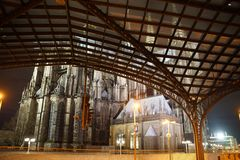 Cologne main station and Cologne Cathedral. The Cologne Cathedral behind the roof of the Cologne main station, at night Royalty Free Stock Photo