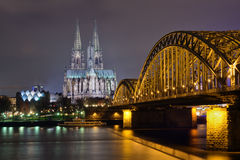 Cologne at night. Cologne cathedral and railway bridge at night royalty free stock photography