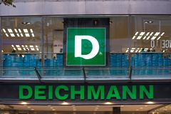 Cologne, North Rhine-Westphalia/germany - 17 10 18: deichmann sign in cologne germany in the evening. Cologne, North Rhine-Westphalia/germany - 17 10 18: an royalty free stock images