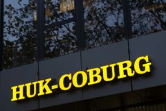 Huk coburg sign on an building in cologne germany royalty free stock photo