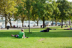 Cologne. Park. COLOGNE, GERMANY - SEPTEMBER 24: Young enjoying a public park on a sunny afternoon in September 24, 2013 in Cologne, Germany. Cologne is a popular Royalty Free Stock Image