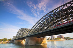 Cologne Railway Bridge. A shot of the railway bridge going out of Cologne with a train just starting to cross rhe bridge Royalty Free Stock Images