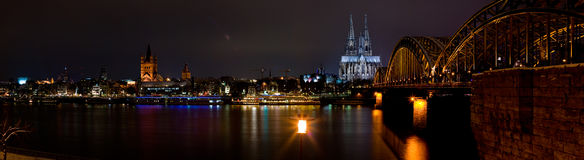 Cologne riverfront. A night panorama of the waterfront of Cologne, Germany, including the Cologne Cathedral and Hohenzollern Bridge Stock Image