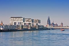 Cologne, Riverfront. Cologne, Crane buildings with cathetral and church Groß St. Martin Royalty Free Stock Photo