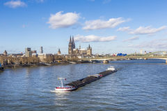 Cologne skyline with dome and bridge and ship on river Rhine Stock Images
