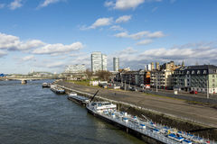 Cologne skyline with dome and bridge and ships on pier Royalty Free Stock Photos
