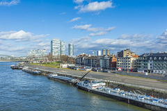 Cologne skyline with ships on pier Stock Photography