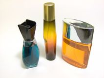 Cologne Trio. These smell sweet - cologne/perfume bottles in an arrangement Royalty Free Stock Images