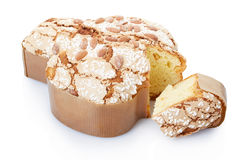 Colomba, italian Easter cake with slice. Colomba, italian Easter cake in fom of a dove with slice on white, clipping path included royalty free stock photography