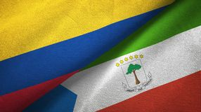 Colombia and Equatorial Guinea two flags textile cloth, fabric texture. Colombia and Equatorial Guinea two folded flags together royalty free illustration