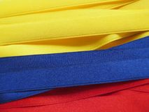 Colombia flag or banner. Made with Yellow, blue and red ribbons royalty free stock photos