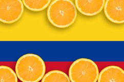 Colombia flag in citrus fruit slices horizontal frame. Colombia flag in horizontal frame of orange citrus fruit slices. Concept of growing as well as import and royalty free stock photos