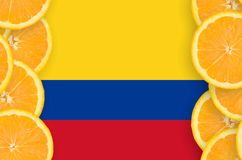 Colombia flag in citrus fruit slices vertical frame. Colombia flag in vertical frame of orange citrus fruit slices. Concept of growing as well as import and royalty free illustration