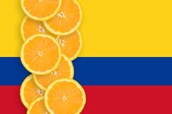 Colombia flag and citrus fruit slices vertical row. Colombia flag and vertical row of orange citrus fruit slices. Concept of growing as well as import and export royalty free illustration