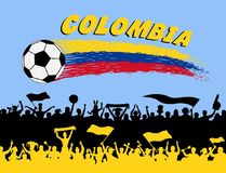 Colombia flag colors with soccer ball and Colombian supporters s. Ilhouettes. All the objects, brush strokes and silhouettes are in different layers and the text Stock Image