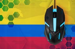 Colombia flag and computer mouse. Concept of country representing e-sports team. Colombia flag and modern backlit computer mouse. Concept of country representing royalty free stock photography