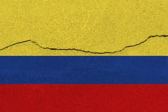 Colombia flag on concrete wall with crack. Patriotic grunge background. National flag of Colombia royalty free stock photo