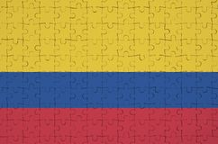 Colombia flag is depicted on a folded puzzle royalty free stock photos