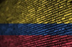 Colombia flag is depicted on the screen with the program code. The concept of modern technology and site development.  royalty free stock photo