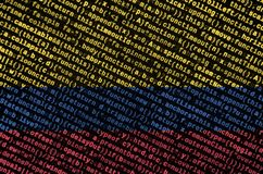 Colombia flag is depicted on the screen with the program code. The concept of modern technology and site development.  stock photography