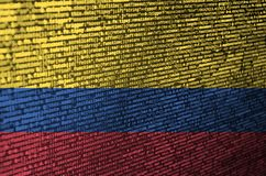 Colombia flag is depicted on the screen with the program code. The concept of modern technology and site development.  stock illustration