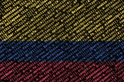 Colombia flag is depicted on the screen with the program code. The concept of modern technology and site development.  stock image