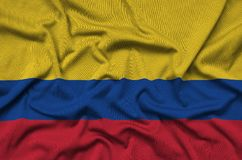 Colombia flag is depicted on a sports cloth fabric with many folds. Sport team banner. Colombia flag is depicted on a sports cloth fabric with many folds. Sport stock image