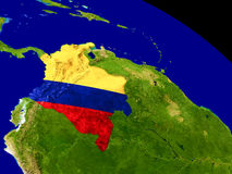 Colombia with flag on Earth Stock Image