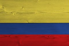 Colombia flag painted on old wood plank. Patriotic background. National flag of Colombia vector illustration