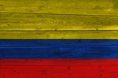 Colombia flag painted on old wood plank. Patriotic background. National flag of Colombia stock photography