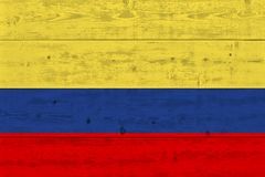 Colombia flag painted on old wood plank. Patriotic background. National flag of Colombia stock images